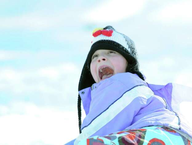 Delila Brien, 11, of Greenwich, screams at the end of a sled ride down a steep hill at the Western Greenwich Civic Center during the aftermath of the blizzard that hit Greenwich, Saturday, Feb. 9, 2013. Photo: Bob Luckey / Greenwich Time