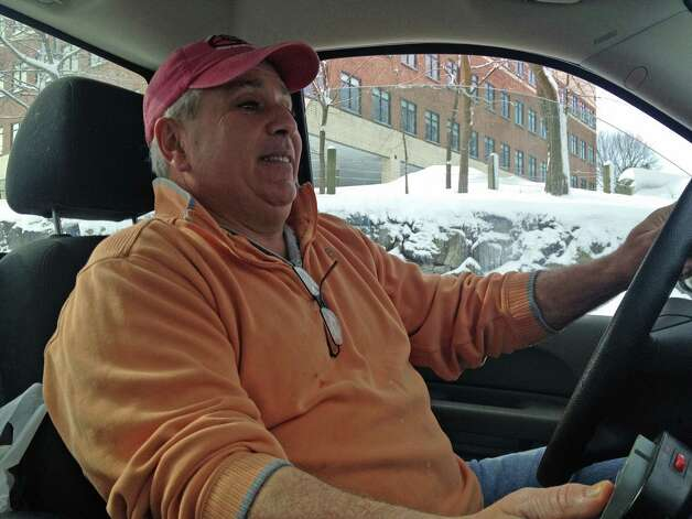 Plow truck driver Mark Anaston of Stamford behind the wheel of his Chevy Silverado while clearing the parking lot of The Boat Yard restaurant next to the Darien town line on Saturday morning Photo: John Nickerson