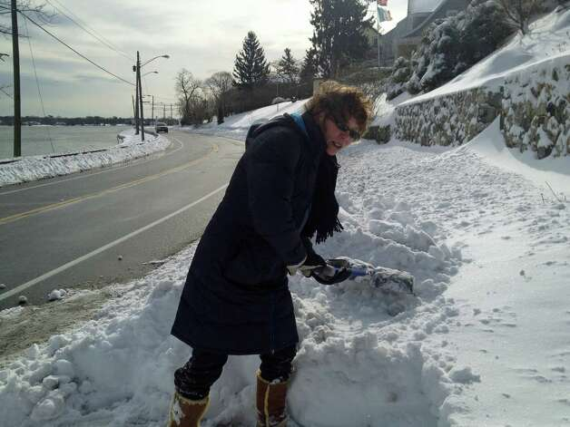 Elizabeth Luehrs of Weed Street on upper Holly Pond said shoveling the heavy snow was miserable, but she would rather do that than get flooded out again. Photo: John Nickerson