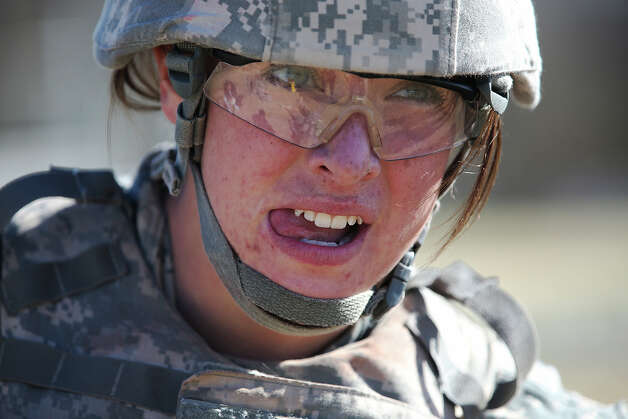 Pfc. Caydee (cq) Woodward, of Shelby, Iowa, goes through medic training at Fort Sam Houston, Thurday, Jan. 31, 2013. She is part of the Ft. Sam Houston 232nd Medical Battalion undergoing 16 weeks of training. Women make up one in five of the 2,600 soldiers going through the training. Photo: Jerry Lara, San Antonio Express-News / San Antonio Express-News