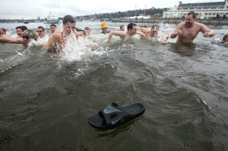 A shoe escapes as plungers dip into the chilly water of Lake Union during the Special Olympics Washington Polar Plunge on Saturday, February 9, 2013 at South Lake Union Park in Seattle. Nearly 600 plungers participated in the event, part of a fundraiser for Special Olympics Washington. Photo: JOSHUA TRUJILLO, SEATTLEPI.COM / SEATTLEPI.COM
