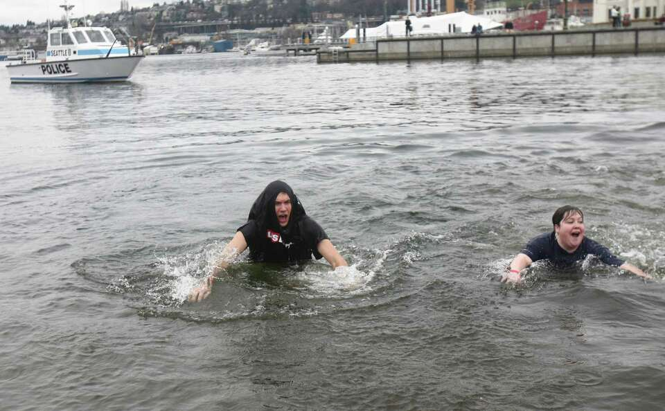 Plungers dip into the chilly water of Lake Union during the Special Olympics Washington Polar Plunge