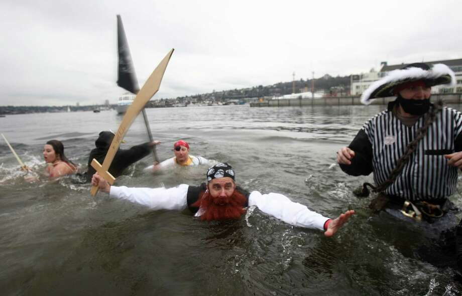 Plungers dip into the chilly water of Lake Union during the Special Olympics Washington Polar Plunge on Saturday, February 9, 2013 at South Lake Union Park in Seattle. Nearly 600 plungers participated in the event, part of a fundraiser for Special Olympics Washington. Photo: JOSHUA TRUJILLO, SEATTLEPI.COM / SEATTLEPI.COM