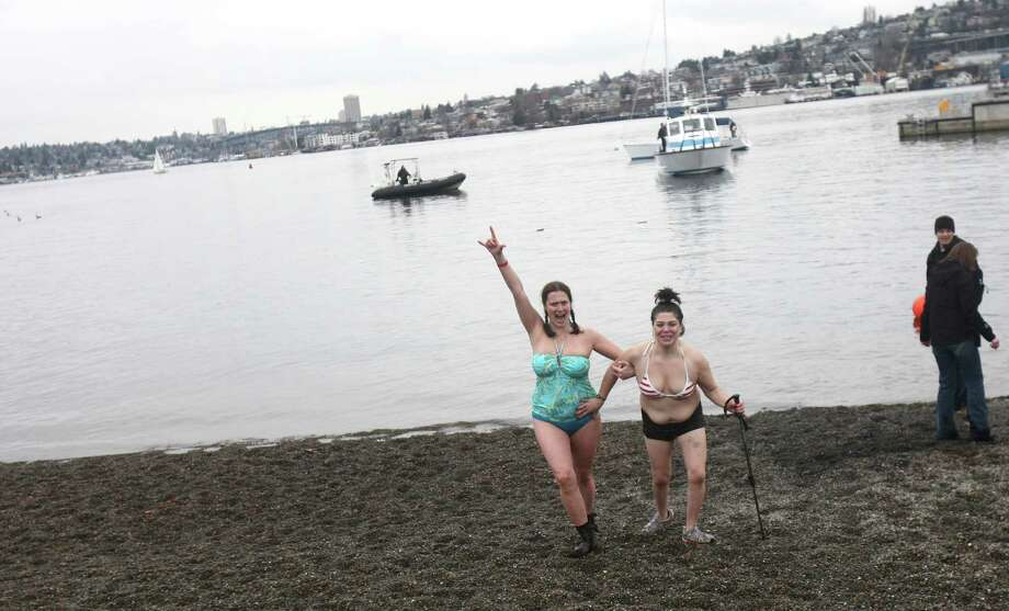 Plungers celebrate after dipping in the chilly water of Lake Union during the Special Olympics Washington Polar Plunge on Saturday, February 9, 2013 at South Lake Union Park in Seattle. Nearly 600 plungers participated in the event, part of a fundraiser for Special Olympics Washington. Photo: JOSHUA TRUJILLO, SEATTLEPI.COM / SEATTLEPI.COM