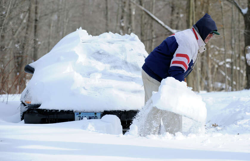 Dave Grosso digs out his car and driveway on Umpawaug Road in Redding Saturday, Feb. 9, 2012, after