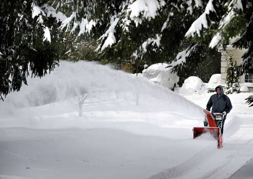Tony Sousa, of Bethel, snowblows the driveway of his home on Route 53 in Bethel, Conn. Saturday afternoon, Feb. 9, 2013. A blizzard dumped almost a foot of snow on the Danbury area Friday and early Saturday morning. Photo: Carol Kaliff / The News-Times
