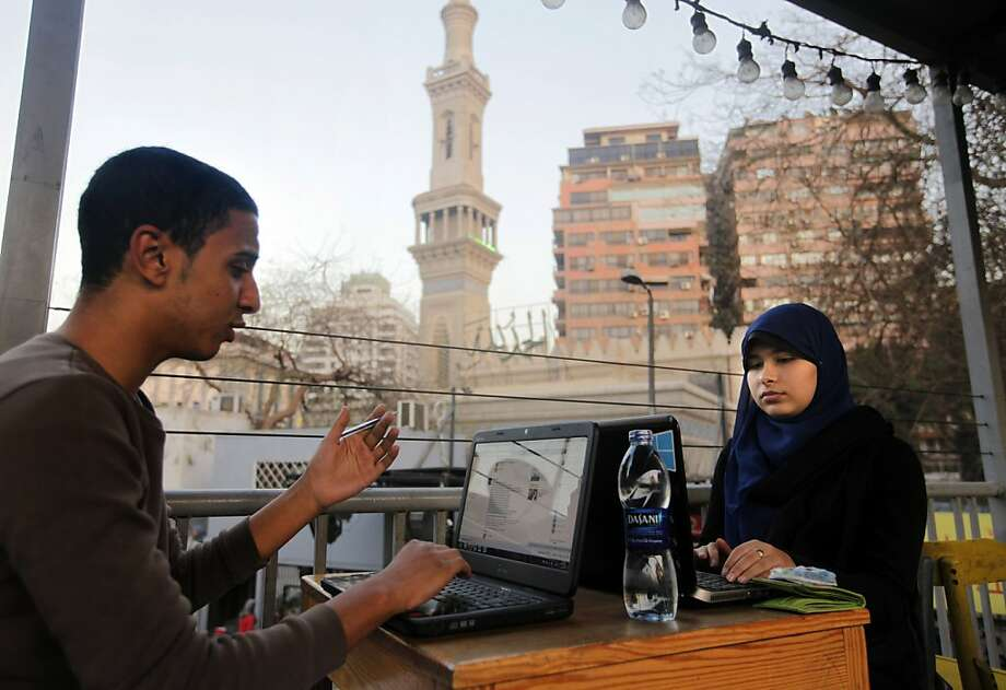 Egyptians log on to the Internet at a community center in front of a mosque in Cairo, Egypt, Saturday, Feb. 9, 2013. A Cairo court on Saturday ordered the government to block access to the video-sharing website YouTube for 30 days for carrying an anti-Islam film that caused deadly riots across the world. (AP Photo/Amr Nabil) Photo: Amr Nabil, Associated Press