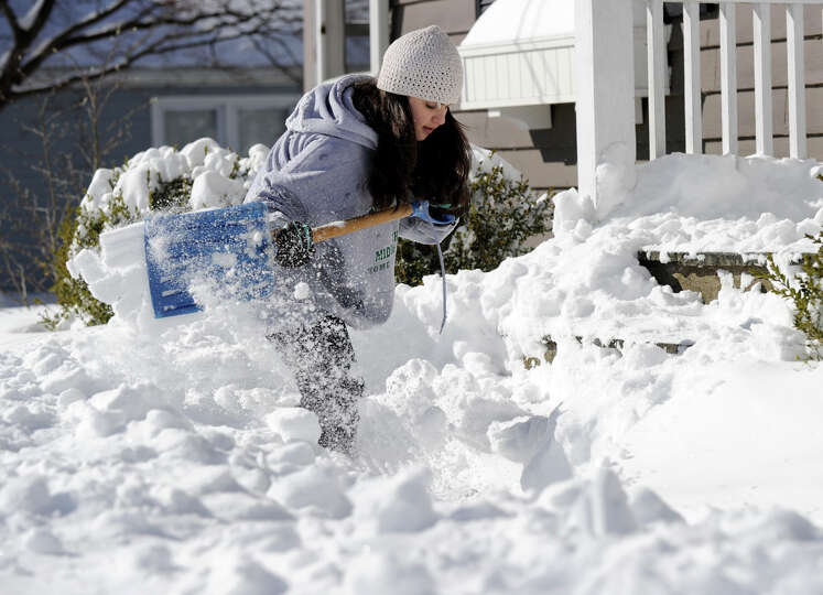 Teresa Forlenzo, 12, of Newtown, shovels the steps and walk of her family home on Glover Ave. in New