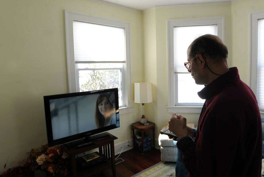 Abilis resident Oren Gershberg watches television at the organization's group home in Glenville where he lives during the aftermath of the blizzard that hit Greenwich, Saturday afternoon, Feb. 9, 2013.   Abilis is a nonprofit organization serving children and adults with developmental and intellectual disabilities. Photo: Bob Luckey / Greenwich Time