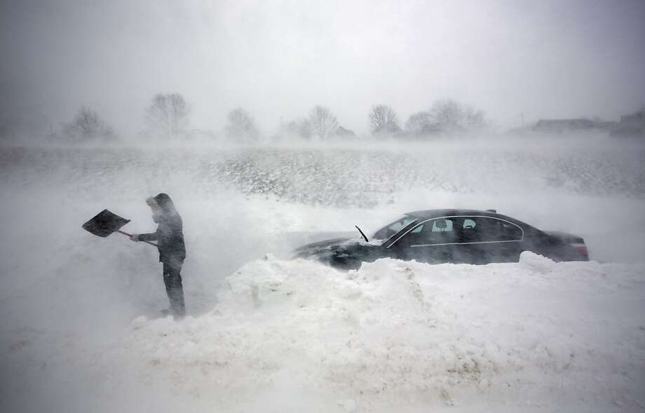 A woman digs out her car after it was blocked in by drifting snow during a blizzard, Saturday, Feb. 9, 2013, in Portland, Maine. The storm dumped more than 30 inches of snow as of Saturday afternoon, breaking the record for the biggest storm on record.  Photo: Robert F. Bukaty, Associated Press