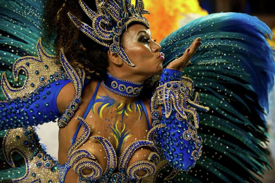 A reveller of Academicos do Tatuape samba school performs during the first night of Carnival parades