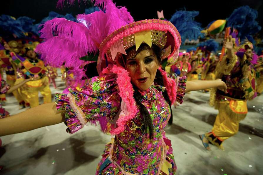A reveller of Rosas de Ouro samba school performs during the first night of Carnival parades at Sao