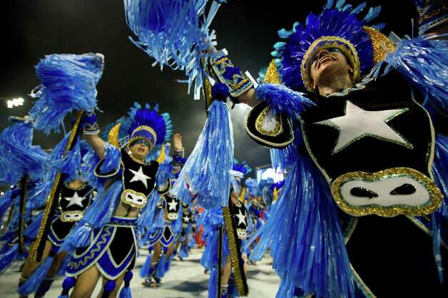 Revellers of Rosas de Ouro samba school perform during the first night of Carnival parades at Sao Paulo on February 08, 2013. Photo: AFP, AFP/Getty Images / 2013 AFP