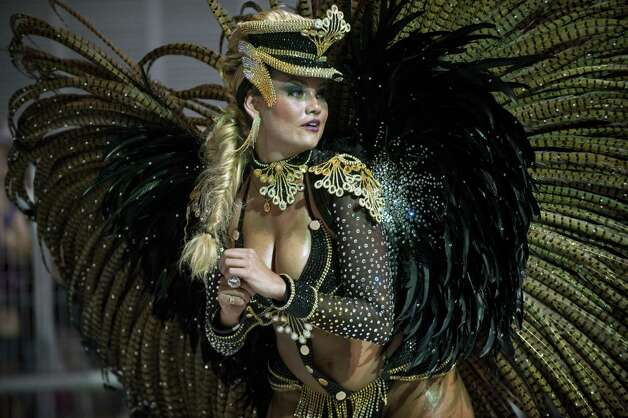 A queen of the drums of the Rosas de Ouro samba school performs during the first night of Carnival parades at Sao Paulo on February 09, 2013. Photo: AFP, AFP/Getty Images / 2013 AFP