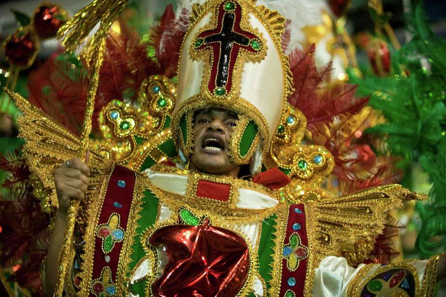 A reveller from Mancha Verde samba school performs during the first night of carnival parade at the Sambadrome in Sao Paulo,Brazil, on February 9, 2013. Photo: AFP, AFP/Getty Images / 2013 AFP