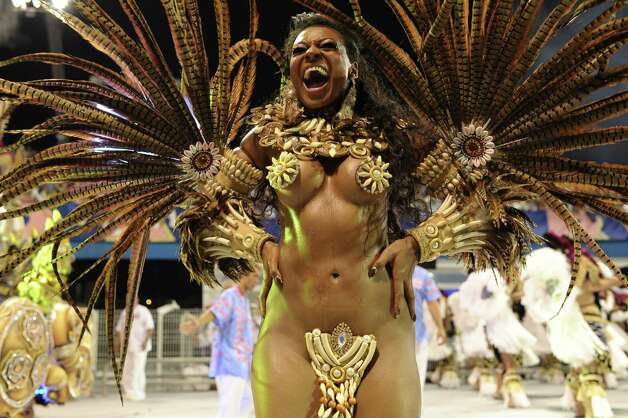 A reveller from Rosas de Ouro samba school performs during the first night of carnival parade at the Sambadrome in Sao Paulo,Brazil, on February 9, 2013. Photo: AFP, AFP/Getty Images / 2013 AFP