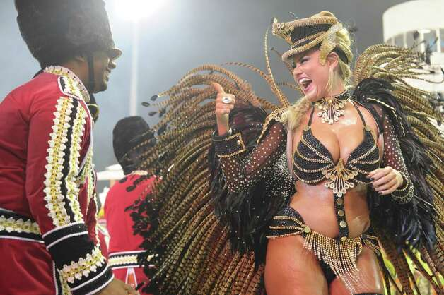 Revellers from Rosas de Ouro samba school perform during the first night of carnival parade at the Sambadrome in Sao Paulo,Brazil, on February 9, 2013. Photo: AFP, AFP/Getty Images / 2013 AFP