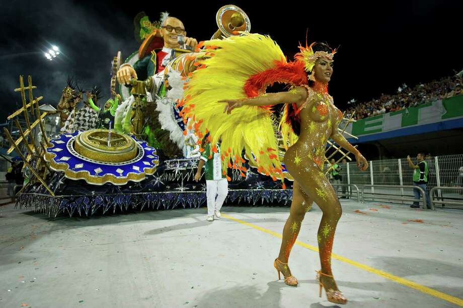 A reveller of Mancha Verde samba school performs during the first night of Carnival parades at Sao Paulo on February 09, 2013. Photo: NELSON ALMEIDA, AFP/Getty Images / 2013 AFP