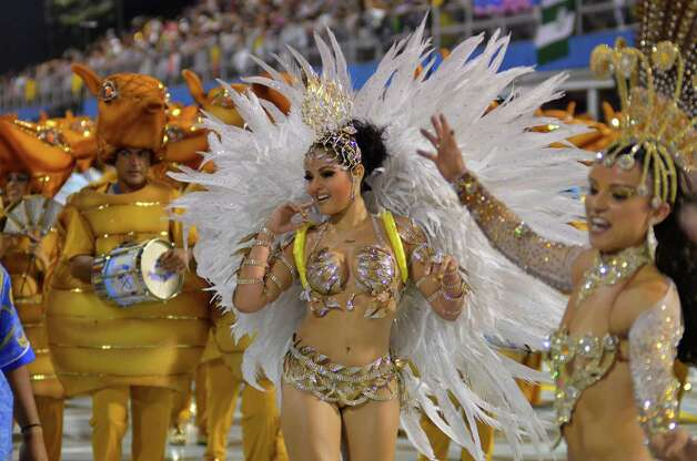 Members of the samba school Academicos do Tatuape dance during the carnival parade at the Anhembi Sambadrome on February 8, 2013 in Sao Paulo, Brazil. Photo: LatinContent/Getty Images