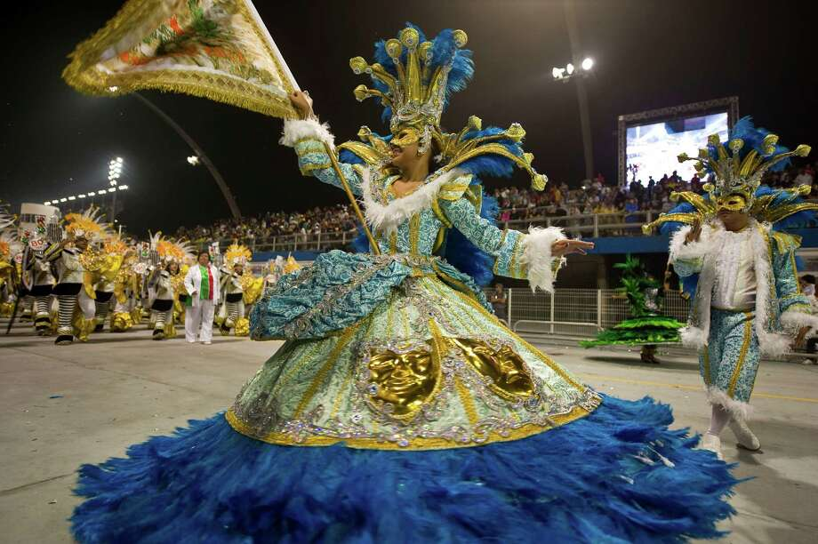 A reveller of X-9 Paulistana samba school performs during the first night of Carnival parades at Sao Paulo on February 09, 2013. Photo: NELSON ALMEIDA, AFP/Getty Images / 2013 AFP