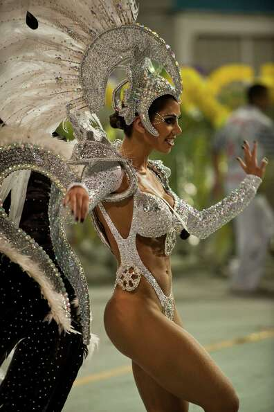 A reveller of X-9 Paulistana samba school performs during the first night of Carnival parades at Sao