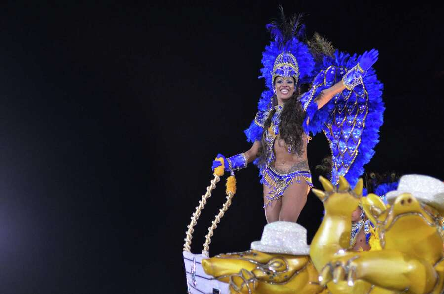 Members of the samba school Academicos do Tatuape dance during the carnival parade at the Anhembi Sa