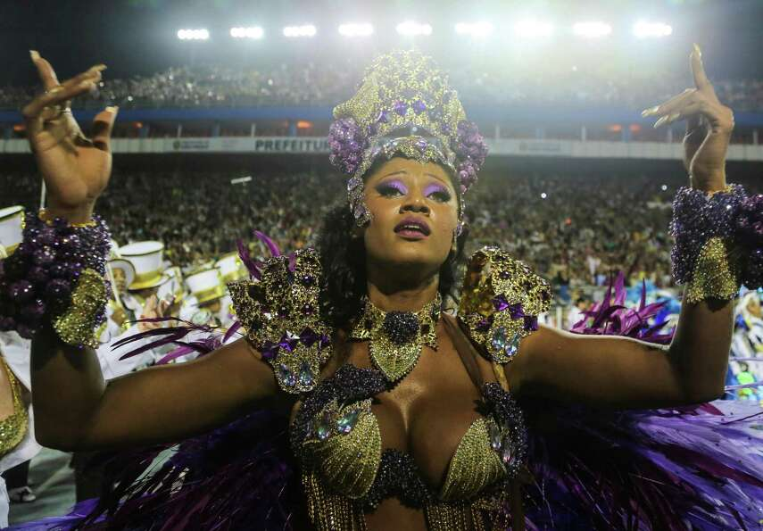 Members of the samba school Vai Vai dance during the carnival parade at the Anhembi Sambadrome on Fe