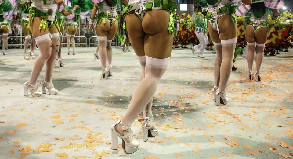 Members of the samba school Mancha Verde dance during the carnival parade at the Anhembi Sambadrome