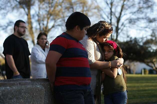 Maria Alba shares a moment with her daughter, Kamyla and son, Jesus. Though the family did not know the victim of the murder they feared for their own safety because they live close to the park. Genelle Conway-Allen was found dead at Allan Witt Park on Friday, Feb. 1. Photo: James Tensuan, The Chronicle