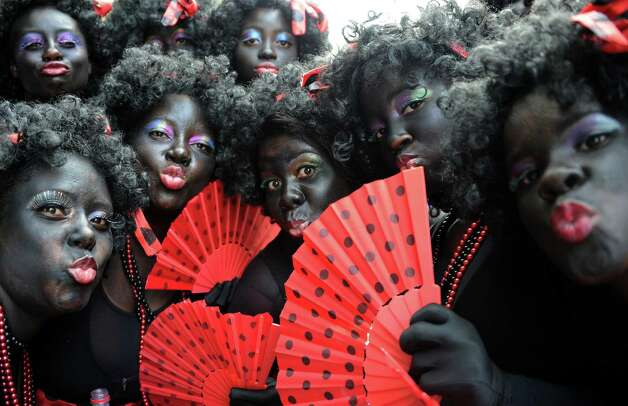 Revellers take part in the 'Cordao do Bola Preta' traditional carnival band parade along Rio Branco avenue, in downtown Rio de Janeiro, Brazil, on February 9, 2013. Photo: VANDERLEI ALMEIDA, AFP/Getty Images / 2013 AFP
