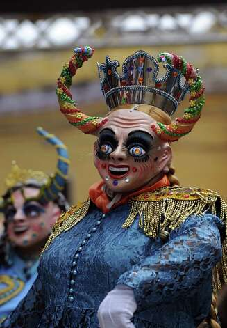 A member of La Diablada dance troupe takes part in Carnival of Oruro, in the mining town of Oruro, 240 km south of La Paz, Bolivia, on February 9, 2013. The Carnival of Oruro was inscribed by UNESCO on the Representative List of the Intangible Cultural Heritage of Humanity in 2008. Photo: AIZAR RALDES, AFP/Getty Images / 2013 AFP