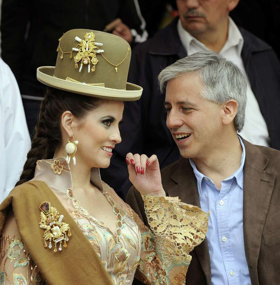 Bolivian Vice-President Alvaro Garcia Linera (R) and his wife Claudia Fernandez are seen at the Morenada Central Cocanis brotherhood during the Carnival of Oruro, in the mining town of Oruro, 240 km south of La Paz. Photo: AIZAR RALDES, AFP/Getty Images / 2013 AFP