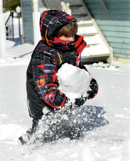 Maximo Dinardo, 6, plays in the snow near his home in Sandy Hook, Conn. Saturday, February 9, 2013.