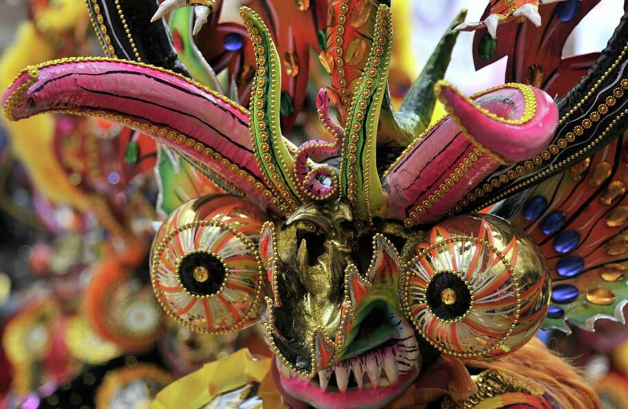 A Diablada brotherhood dancer performs during the Carnival of Oruro, in the mining town of Oruro, 24