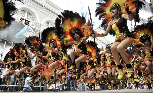 Members of the Tobas brotherhood perform during the Carnival of Oruro, in the mining town of Oruro, 240 km south of La Paz, Photo: AIZAR RALDES, AFP/Getty Images / 2013 AFP
