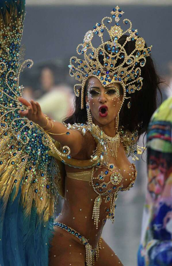A dancer from the Aguia de Ouro samba school performs during a carnival parade in Sao Paulo, Brazil. Photo: AP