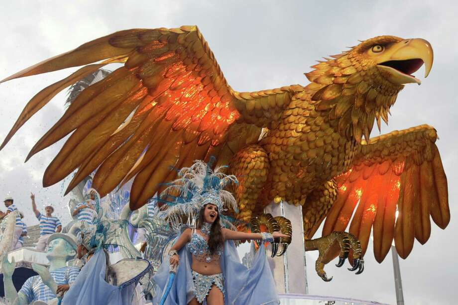 A dancer from the Aguia de Ouro samba school performs on a float during a carnival parade in Sao Paulo, Brazil. Photo: AP