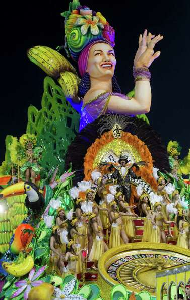 Dancers from the Mancha Verde samba school perform on a float during a carnival parade in Sao Paulo.