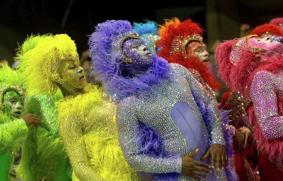 Dancers from the Rosas de Ouro samba school perform during a carnival parade in Sao Paulo, Brazil.  The Carnival season culminates on Tuesday with street revelry and the pageantry of the Rex and Zulu parades. Photo: AP