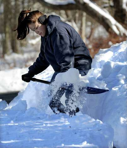 Andrea Hanna, 21, shovels the driveway of her home on Hawleyvilel Road in Newtown, Conn. Saturday, February 9, 2013. A blizzard dumped almost two feet of snow in the area. Photo: Carol Kaliff / The News-Times
