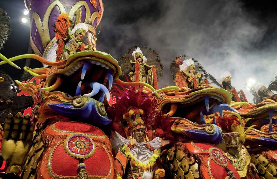 Dancers from the Rosas de Ouro samba school perform on a float during a carnival parade in Sao Paulo, Brazil. Photo: AP