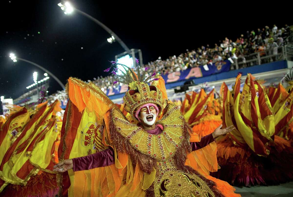 Dancers from the Rosas de Ouro samba school perform during a carnival parade in Sao Paulo, Brazil.
