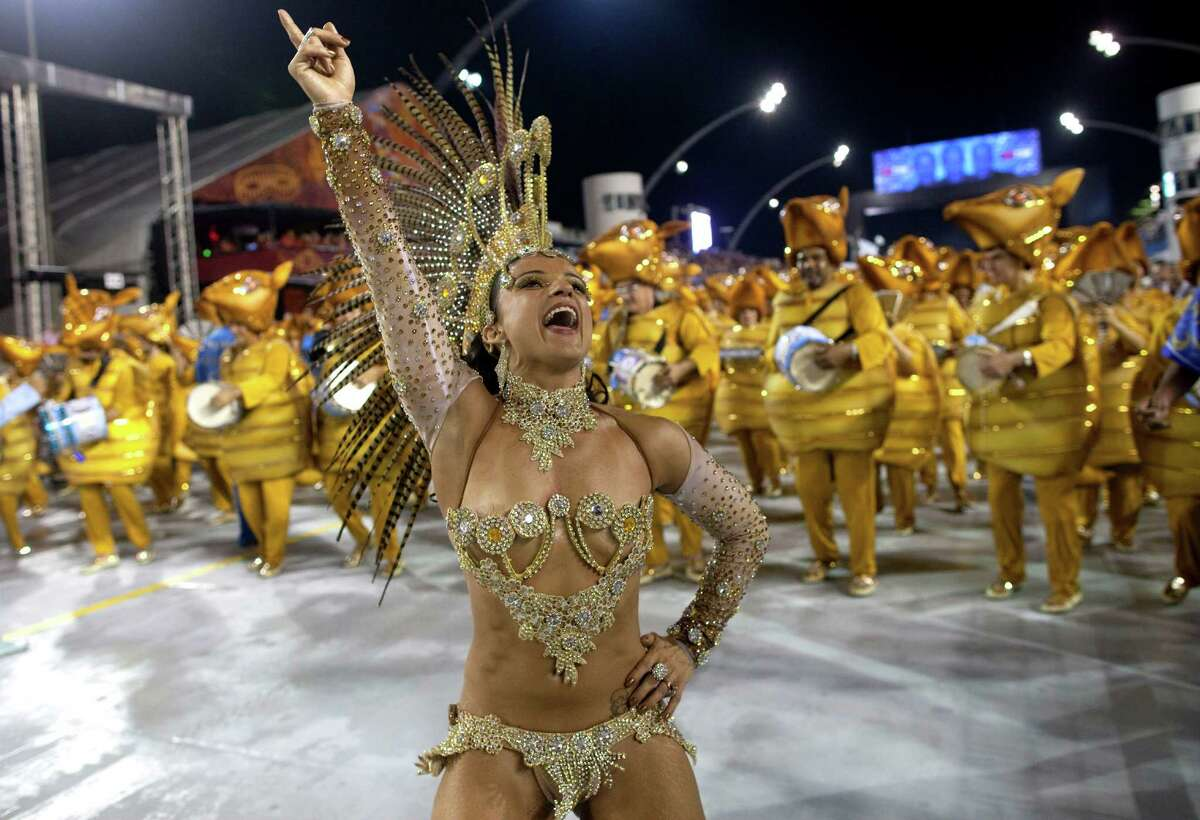 A dancer in costume from the Academicos do Tatuape samba school performs during a Carnival parade in Sao Paulo, Brazil, late Friday, Feb. 8, 2013.