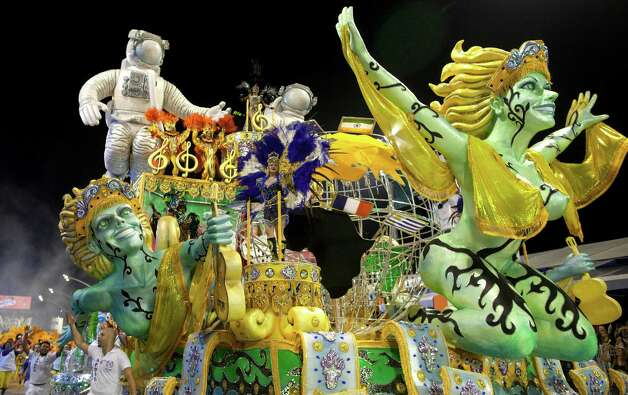 Dancers from the Academicos do Tatuape samba school perform on a float during a carnival parade in Sao Paulo, Brazil. Photo: AP