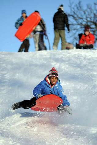 A.J. Cooper catches air on a hill in Cummings Park in Stamford, Conn., on Saturday, February 9, 2013. Photo: Lindsay Perry / Stamford Advocate