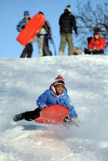 A.J. Cooper catches air on a hill in Cummings Park in Stamford, Conn., on Saturday, February 9, 2013