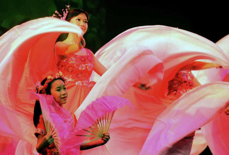 Members of the Chinese Cultural Center dance school perform the opening ceremony of the annual Chinese New Year celebration at the Egg on Saturday Feb. 9, 2013 in Albany, N.Y. .(Michael P. Farrell/Times Union) Photo: Michael P. Farrell