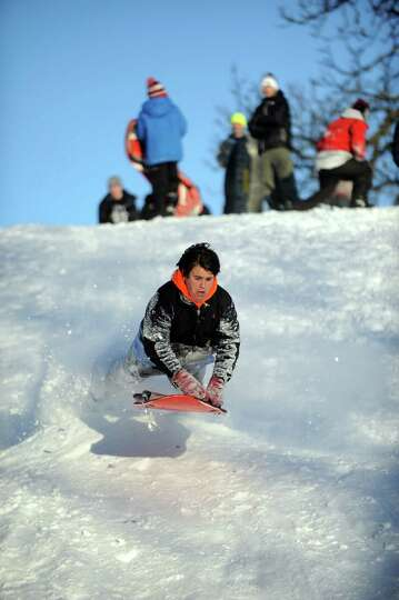 Hunter Bridges catches air on a hill in Cummings Park in Stamford, Conn., on Saturday, February 9, 2