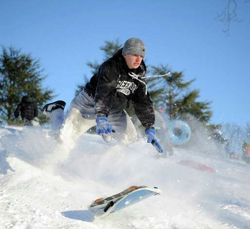 Marc Grasso catches air on a hill in Cummings Park in Stamford, Conn., on Saturday, February 9, 2013. Photo: Lindsay Perry / Stamford Advocate