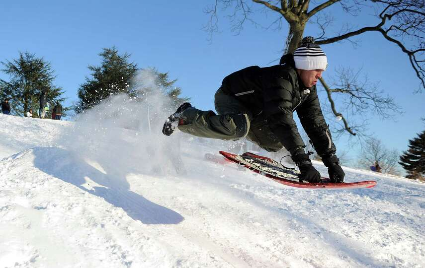 Claudio Fidaleo catches air on a hill in Cummings Park in Stamford, Conn., on Saturday, February 9,